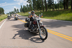 Albert Diaz on Aidan's Ride to raise money for the Aiden Jack Seeger nonprofit foundation to help raise awareness and find a cure for ALD (Adrenoleukodystrophy) during the annual Sturgis Black Hills Motorcycle Rally. Vanocker Canyon between Sturgis and Nemo, SD, USA. Tuesday August 8, 2017. Photography ©2017 Michael Lichter.