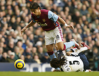 Photo: Chris Ratcliffe.<br />Tottenham Hotspur v Aston Villa. The Barclays Premiership. 21/01/2006.<br />Milan Baros (L) stands all over Edgar Davids of Spurs on his way through.