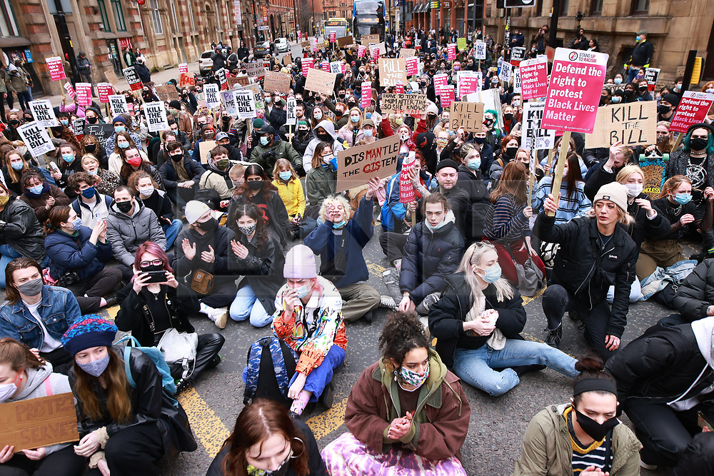 """© Licensed to London News Pictures. 27/03/2021. Manchester, UK. Hundreds at """" Kill the Bill """" and Reclaim the Streets demonstrations in Manchester City Centre, in opposition to the Police, Crime, Sentencing and Courts Bill 2021 that is currently before Parliament and after the death of Sarah Everard in London . Photo credit: Joel Goodman/LNP"""