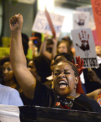 A woman yells during a protest marchSaturday, September 24, 2016 in Charlotte, NC, USA. Protesters came together for the fifth straight night to protest following the fatal shooting of Keith Lamont Scott. Keith Lamont Scott was shot and killed by Charlotte-Mecklenburg Police Officer Brentley Vinson on Tuesday afternoon. Photo by Jeff Siner/Charlotte Observer/TNS/ABACAPRESS.COM