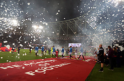 The players make their way onto the pitch through bubbles before the game
