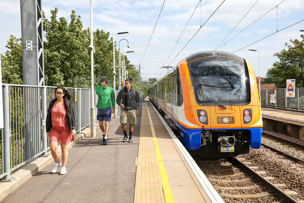 © Licensed to London News Pictures. 30/08/2019. London, UK. An electric train leave Harringay Green Lanes railway station for Barking Station in East London. <br /> London Overground's Gospel Oak to Barking line is exclusively operated by new four-car electric air-conditioned trains, doubling capacity, restoring a 15 minute frequency and bringing greater reliability to the service. To celebrate this milestone, the Mayor of London and Transport for London (TfL) are offering customers a month of free travel on the line from Saturday 31 August to Tuesday 1 October inclusive. The new state-of-the-art trains can carry nearly 700 people and feature free WiFi, real-time information screens, air-conditioning, USB charging points and more wheelchair spaces. Photo credit: Dinendra Haria/LNP