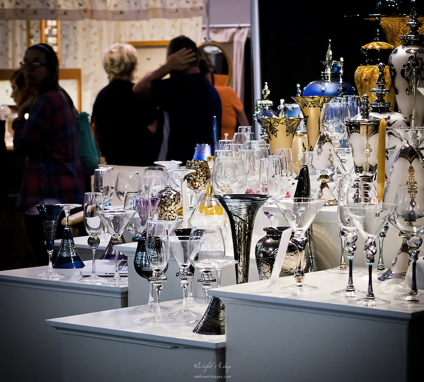 An indoor display of fine glassware is one of numerous displays by vendors in the large indoor gallery.