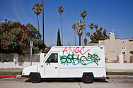 Street art in Los Angeles..L.A. has become the new ground zero for avant-guard and cutting edge street and graffiti. Artist from around the world now come to L.A. to post their work..A white truck is tagged in the Mid-Wilshire district of L.A.