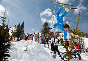 PRICE CHAMBERS / NEWS&GUIDE<br /> Hundreds adorned in their best one-pieces and other fantastic costumes gathered near the top of the Thunder chair lift on Gaper Day, April 1, for a fun-filled parade of crazy skiing and tomfoolery.