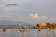Family sea kayaking on Flathead Lake in Somers, Montana, USA  MR