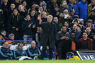Jose Mourinho, the Chelsea Manager waves to the Chelsea fans as they cheer his name. UEFA Champions league group G match, Chelsea v Porto at Stamford Bridge in London on Wednesday 9th December 2015.<br /> pic by John Patrick Fletcher, Andrew Orchard sports photography.