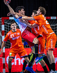 The Dutch handball player Gorkem Bicer, Jasper Adams in action during the European Championship qualifying match against Turkey in the Topsport Center Almere.