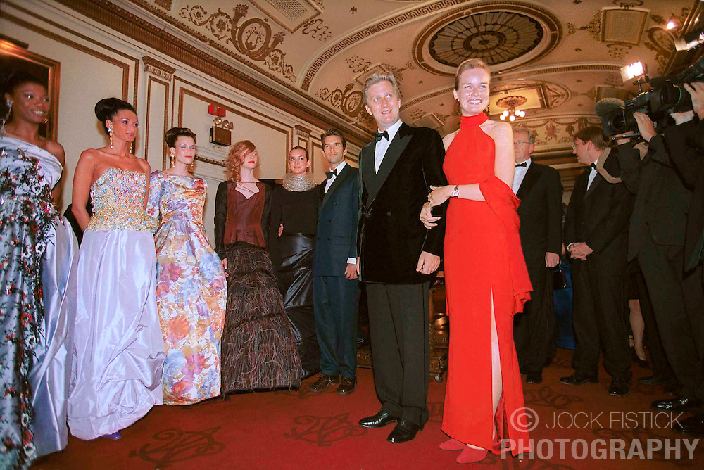 NEW YORK, NY -  SEPT. 11, 2000 - Prince Philippe and Princess Mathilde of Belgium make their entrance to the the Belgian-American Chamber of Commerce reception and dinner held at the Metropolitan Club where models at left show off Belgian Haute Couture. (Photo © Jock Fistick)