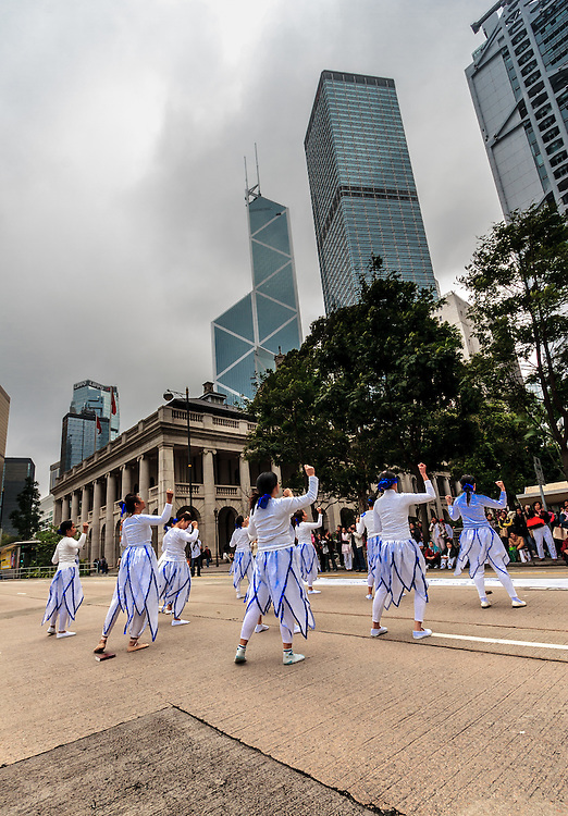 Practisers of Tai Chi in front of The Legislative Council Building on Hong Kong Island. Since the 1980s, there has been a tradition for  Filipina domestic workers to gather in Statue Square every Sunday that is their usual rest day of the week.