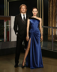 The wax figures of Brad Pitt and Angelina Jolie before they were moved apart at Madame Tussauds London following the news of their divorce.