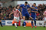 Diego Costa of Chelsea breaks away from Joe Allen of Stoke city (l).  Premier league match, Stoke City v Chelsea at the Bet365 Stadium in Stoke on Trent, Staffs on Saturday 18th March 2017.<br /> pic by Andrew Orchard, Andrew Orchard sports photography.