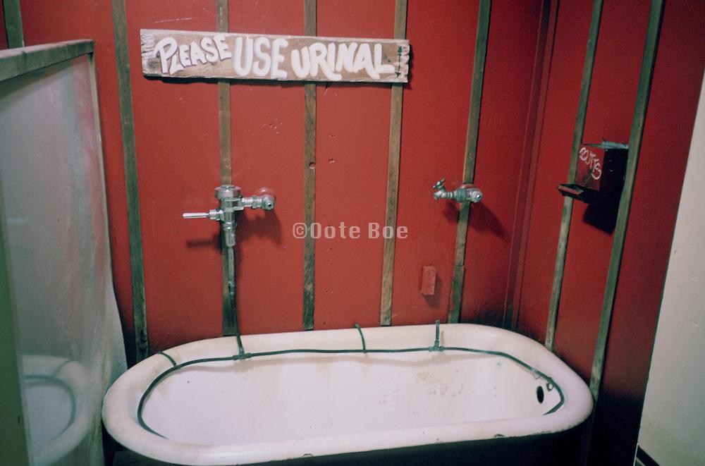 a bathtub used as an urinal