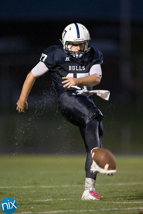 Greg Waslo (17) of the Hickory Ridge Ragin' Bulls punts the football during first half action against the East Rowan Mustangs at Hickory Ridge High School on October 2, 2015 in Harrisburg, North Carolina.  The Ragin' Bulls defeated the Mustangs 20-7.  (Brian Westerholt/Special to the Tribune)