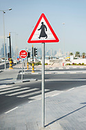 A pedestrian crossing sign uses a culturally appropriate illustration of an Arab man wearing a dishdash in Doha, Qatar