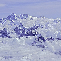 An aerial view of Mount Everest & Lhotse (bkg) & other peaks of Khumbu region, which  tower above pre-monsoon clouds in Nepal.