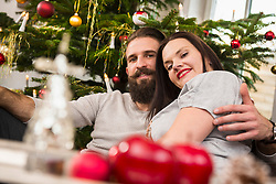 Portrait of couple embracing at home
