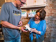 18 OCTOBER 2019 - SIGOURNEY, IOWA: US Senator AMY KLOBUCHAR (D-MN) autographs a book for an Iowa voter after a campaign event in Sigourney, IA. Sen. Klobuchar is on barnstorming bus tour of southeast Iowa this weekend. She is campaigning to be the Democratic nominee for the US Presidency. In addition to campaign meet and greet events, she stopped at a biofuels plant to learn about the difficulties farmers and biofuels producers face because of the trade war with China. Iowa holds the first selection event of the Presidential election cycle. The Iowa caucuses are Feb. 3, 2020.         PHOTO BY JACK KURTZ