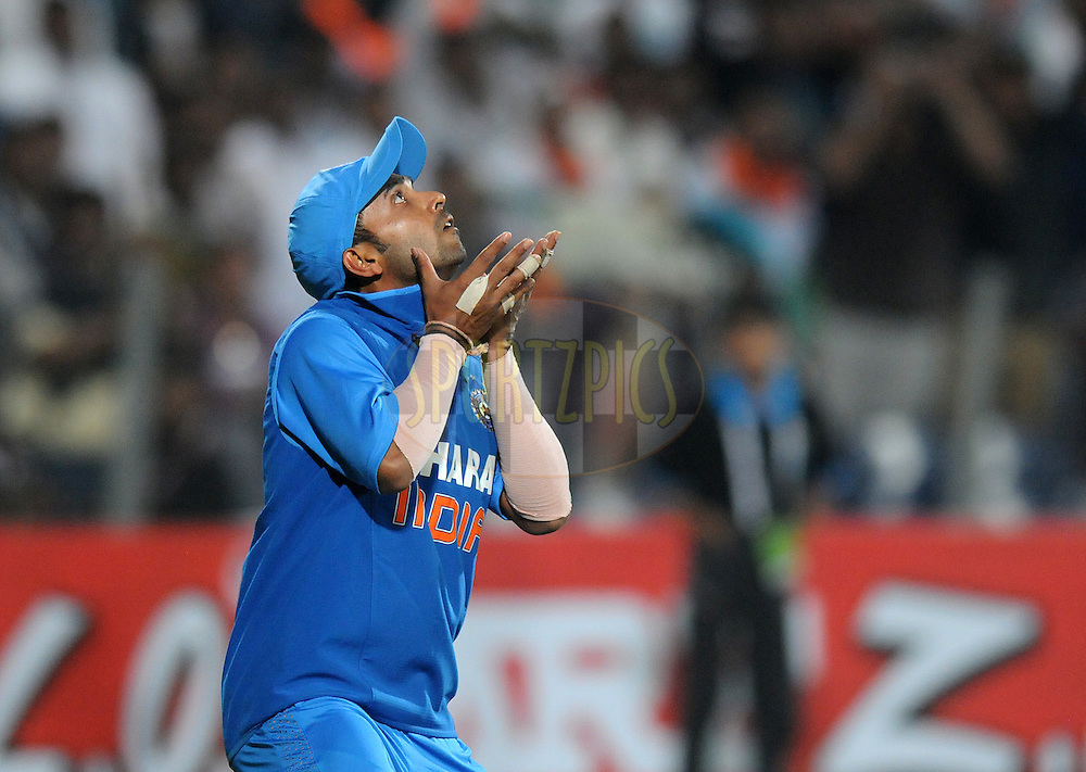 Ajinkya Rahane of India gets ready to take a catch get Eoin Morgan captain of England out during the first Airtel T20 Match between India and England held at Subrata Roy Sahara stadium in Pune on the  20th December 2012..Photo by  Pal Pillai/BCCI/SPORTZPICS .