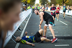 © Licensed to London News Pictures . 15/10/2017 . Manchester , UK . Athletes reach the finish line in the Greater Manchester Half Marathon in Old Trafford . Photo credit : Joel Goodman/LNP