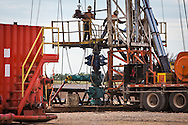 Oil field works at a Nabor's frack site on a drilling rig on the outskirts of Stillwater Oklahoma.