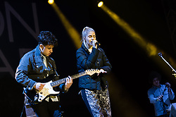 © Licensed to London News Pictures. 06/09/2014. Isle of Wight, UK. London Grammar performing live at Bestival 2014 Day 3 Saturday.  In this picture Dan Rothman (left), Hannah Reid (centre), Dominic Major (right).  London Grammar are a British electronic pop trio formed by Hannah Reid (vocals), Dan Rothman (guitar) and Dominic 'Dot' Major (keyboard/drums).  This weekend's headliners include Chic featuring Nile Rodgers, Foals and Outcast.   Bestival is a four-day music festival held at the Robin Hill country park on the Isle of Wight, England. It has been held annually in late summer since 2004.    Photo credit : Richard Isaac/LNP