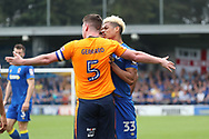 AFC Wimbledon striker Lyle Taylor (33) arguing with Oldham Athletic defender Anthony Gerrard (5) during the EFL Sky Bet League 1 match between AFC Wimbledon and Oldham Athletic at the Cherry Red Records Stadium, Kingston, England on 21 April 2018. Picture by Matthew Redman.