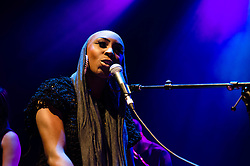 "© Licensed to London News Pictures. 13/03/2013. London, UK.   Laura Mvula performing live at O2 Shepherds Bush Empire, supporting headliner Jessie Ware.   Laura Mvula (née Doublas) is a British soul singer-songwriter from Birmingham.  Her debut album ""Sing to the Moon"" was released on 4 March 2013.   Photo credit : Richard Isaac/LNP"