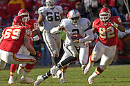 Oakland Raiders quarterback Aaron Brooks (2) scrabbles up field against Kansas City in the second half at Arrowhead Stadium in Kansas City, Missouri, November 19, 2006.  The Chiefs beat the Raiders 17-13.<br />