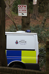 © London News Pictures. 24/02/2014. Farnham, UK. Police guard the entance to a property in Farnham, Surrey where a double shooting has taken place in which two women have been shot dead. An 82 year-old man was arrested at the scene on suspicion of murder. Photo credit: Rob Arnold/LNP