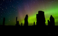 LEWIS AND HARRIS, SCOTLAND - CIRCA APRIL 2016: Aurora Borealis also known as Northern Lights over the famous Callanish Stones in Outer Islands of Lewis and Harris in Scotland.