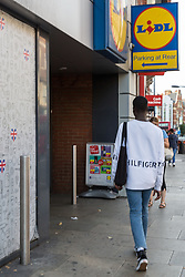 Lance enters Lidl where he was unable to obtain a knife in an exercise where a 17-year-old visited numerous big brand shops on Streatham High Road in an attempt to purchase a knife to illustrate the extent of knife control and age checking in London stores. Streatham, London, August 30 2019.