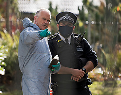 © Licensed to London News Pictures. 06/10/2020. London, UK. Police and forensics at a property on Clayponds Lane, Brentford, west London,  where the bodies of two people, a woman and a child were discovered at a residential property. A man, believed aged in his 40s, was found suffering stab injuries. Photo credit: Ben Cawthra/LNP