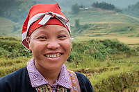 SAPA, VIETNAM - CIRCA SEPTEMBER 2014:  Young woman from the Red Dao minority smiling in Ta Phin Village near Sapa, north Vietnam.
