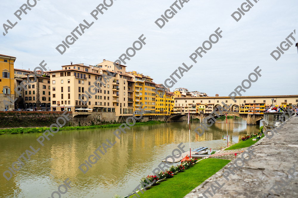 Ponte Vecchio in Florence over the Arno river located in Tuscany region- Italy. Horizontal Image.