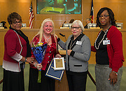 Bertie Simmons presents Marie Aguirre with the Employee of the Month award during a meeting of the Houston ISD Board of Trustees, January 14, 2016.