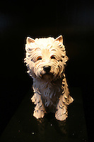Celebrity Eclipse interior photos.Sculpture of a West Highland Terrier outside Michaels Lounge.