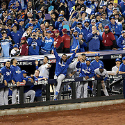 Kansas City Royals players in the dugout celebrate another out by closer Wade Davis in the twelfth inning during the New York Mets Vs Kansas City Royals, Game 5 of the MLB World Series at Citi Field, Queens, New York. USA. 1st November 2015. Photo Tim Clayton