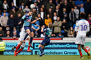 Nick Freeman of Wycombe Wanderers clears the ball under pressure during the EFL Sky Bet League 1 match between Wycombe Wanderers and Portsmouth at Adams Park, High Wycombe, England on 6 April 2019.