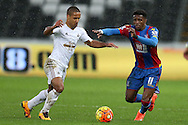Wayne Routledge of Swansea city goes past Wilfried Zaha of Crystal Palace (r). Barclays Premier league match, Swansea city v Crystal Palace at the Liberty Stadium in Swansea, South Wales on Saturday 6th February 2016.<br /> pic by Andrew Orchard, Andrew Orchard sports photography.<br /> contact and payments to Andrew Orchard, 2 Old Vicarage close, Pengam, Blackwood, Gwent. NP12 3TU. Tel 07974 069129.  vat reg no 615 9784 04,  <br /> no unpaid use, All usage chargeable.  if self billing, please bacs to 20 10 26   20034991   Barclays