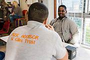A peer advisor sponsored by the St Giles trust talking to a prisoner. HMP/YOI Portland, Dorset, United Kingdom.