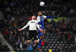 Derby County's Richard Keogh and Wigan Athletic's Leon Clarke battle for the ball during the Sky Bet Championship match at Pride Park, Derby.