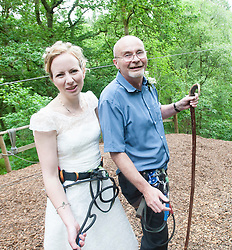 Martin Milner and Colette Gregory tying the knot in the trees at Go Ape Aberfoyle. Colette arriving on the first zip wire with her dad Simon Gregory.