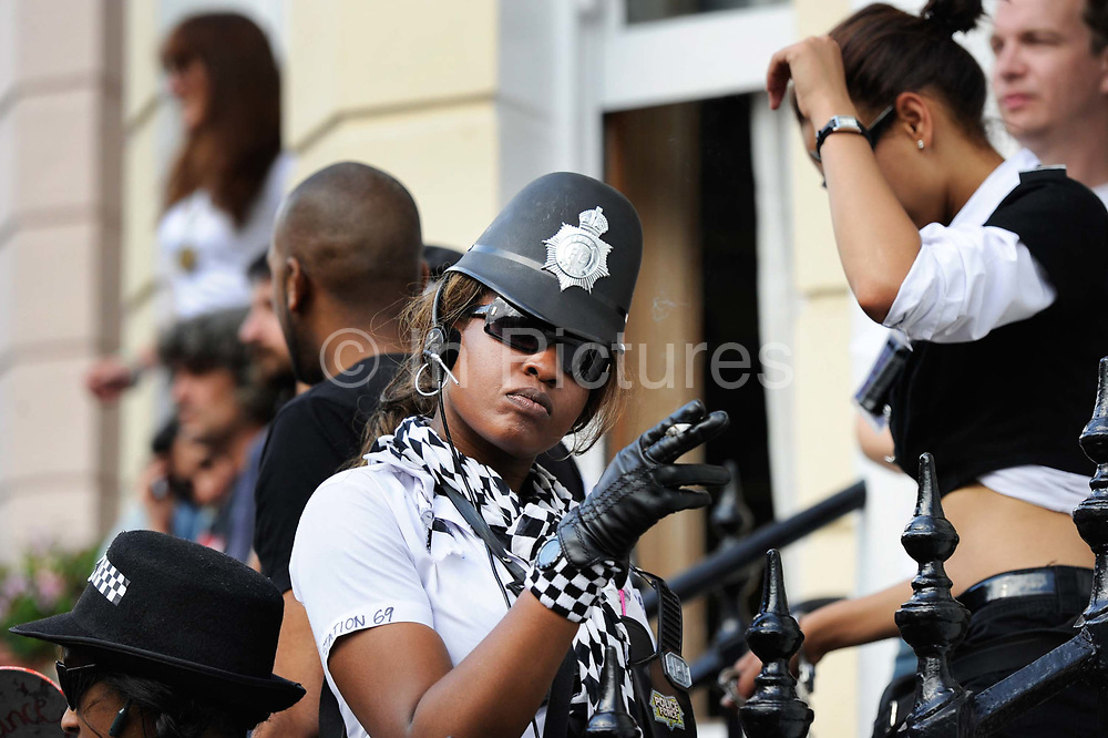 Women dressed as police officers for fun at Notting Hill Carnival, London, 2010.
