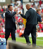 Photograph: Scott Heavey.<br />Aston Villa V Liverpool. FA Barclaycard Premiership match from Villa Park. 24/08/2003.<br />David O'Leary argues with the fourth official Mr.H Webb.