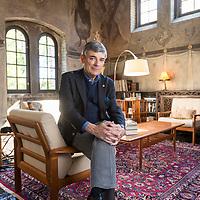 Craig Quackenbush inside his David Adler designed home built in 1928 in Lake Forest.
