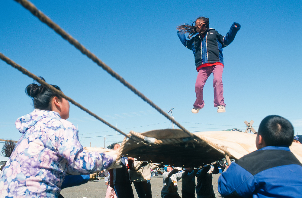 Alaska. Barrow. Young kids having fun at the native blanket toss , or Nalukatak.
