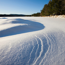 Patterns in the snow on Swanzey Lake in Swanzey, New Hampshire.  Early morning.