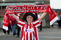 A young Lincoln City fan poses for a photo outside the Emirates Stadium, home of Arsenal  <br /> <br /> <br /> Photographer Craig Mercer/CameraSport<br /> <br /> The Emirates FA Cup Sixth Round - Arsenal v Lincoln City - Saturday 11th March 2017 - The Emirates - London<br />  <br /> World Copyright © 2017 CameraSport. All rights reserved. 43 Linden Ave. Countesthorpe. Leicester. England. LE8 5PG - Tel: +44 (0) 116 277 4147 - admin@camerasport.com - www.camerasport.com