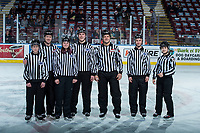 KELOWNA, CANADA - FEBRUARY 17: Linesmen Cody Wanner and Dustin Minty pose on the ice with young BC Hockey officials at the Kelowna Rockets against the Edmonton Oil Kings  on February 17, 2018 at Prospera Place in Kelowna, British Columbia, Canada.  (Photo by Marissa Baecker/Shoot the Breeze)  *** Local Caption ***